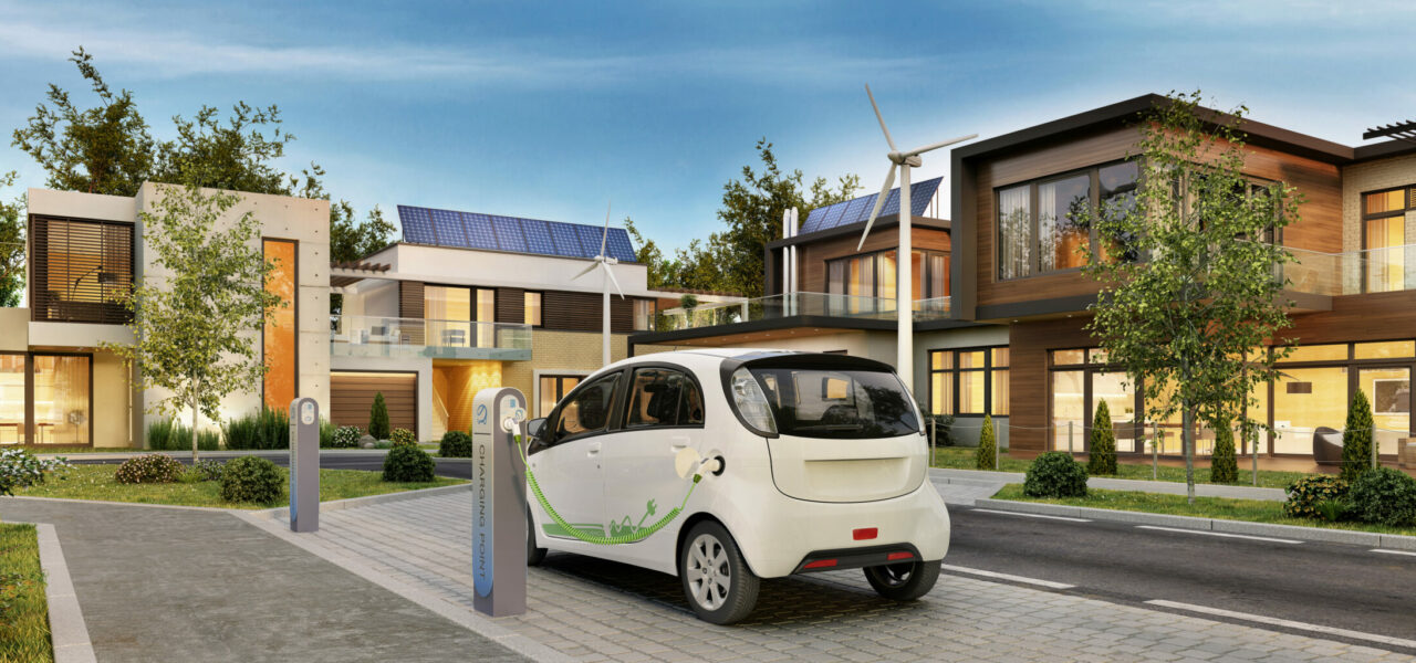 Modern,Houses,With,Solar,Panels,And,Electric,Car.,3d,Rendering